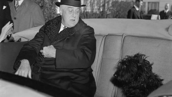 President Franklin D. Roosevelt is joined by Fala, his Scottish terrier, before going to his inauguration in 1941. Roosevelt had to break the news to Fala that he would not be attending the ceremonies.