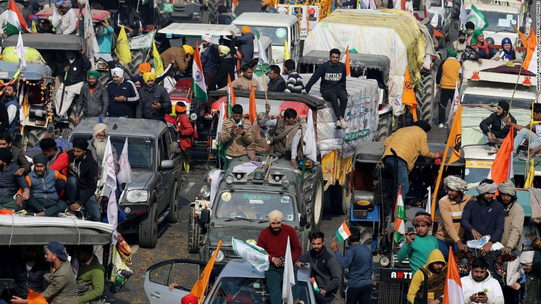 Indian farmers ramp up protest by riding tractors into capital