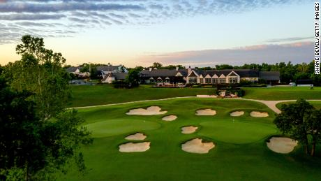 An aerial view of the clubhouse and signature 9th and 18th greens at Southern Hills Country Club.