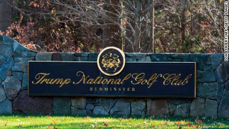 A sign on the stone wall greets visitors to the Trump National Golf Club.