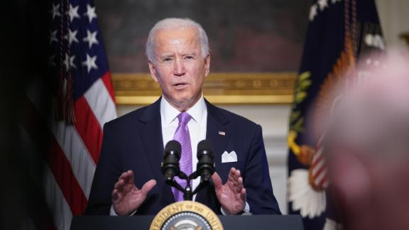 US President Joe Biden speaks on Covid-19 response in the State Dining Room of the White House in Washington, DC on January 26, 2021.