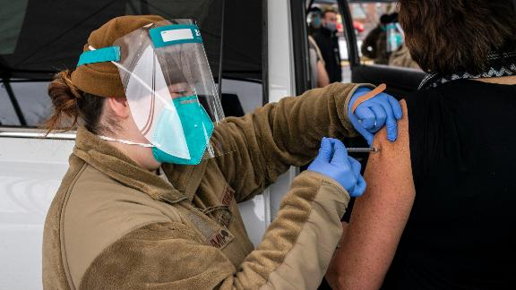 WENATCHEE, WA - JANUARY 26: Washington National Guard medic Caityln Smith administers a COVID-19 vaccine to a patient at Town Toyota Center on January 26, 2021 in Wenatchee, Washington. As Washington opens several mass vaccination sites this week, Gov. Jay Inslee announced that 500,000 doses of the COVID-19 vaccine have been administered in the state. (Photo by David Ryder/Getty Images)
