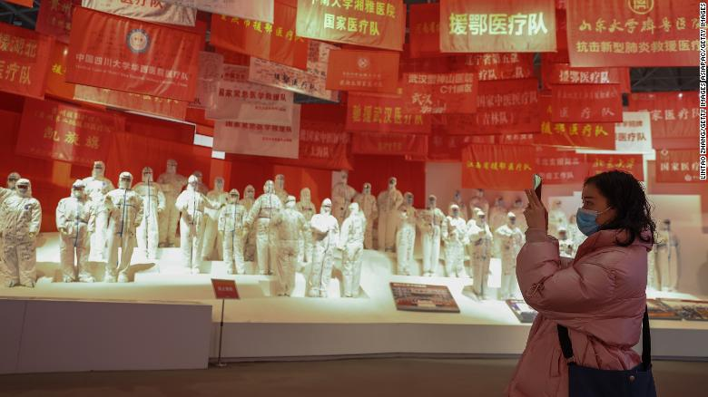 A woman wears a protective mask as she visits an exhibition in Wuhan, China, on the city's fight against the coronavirus, on January 26, 2021.