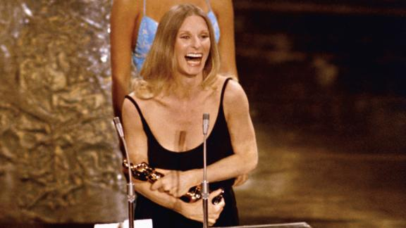 Cloris Leachman accepts her Oscar for best supporting actress at the 1971 Academy Awards presented March 27, 1972 at the Dorothy Chandler Pavilion, Los Angeles. Raquel Welch is seen in the background. (AP Photo)