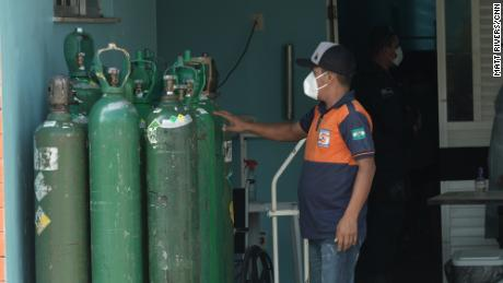 Man with oxygen tanks in Iranduba.
