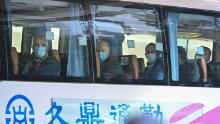 Members of the WHO team investigating the origins of the coronavirus pandemic leave The Jade Hotel on a bus after completing their quarantine in Wuhan, on January 28.