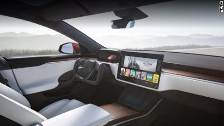 The new interior of the Model S includes a rectangular steering wheel with no stalks and a 17-inch high-definition screen in the center console.