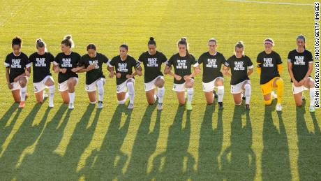 North Carolina Courage players kneel during the national anthem during a game against the Washington Spirit.