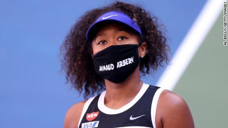 Osaka wears a mask with the name, Ahmaud Arbery, stenciled on it.