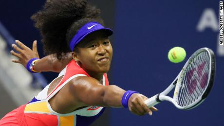 Osaka returns the ball during her women's singles semifinal match against Jennifer Brady in the 2020 US Open.