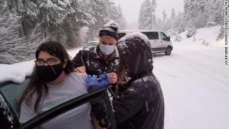 Stranded in a snowstorm in Oregon, health care workers administered leftover doses of Covid-19 vaccines to motorists stuck alongside them.