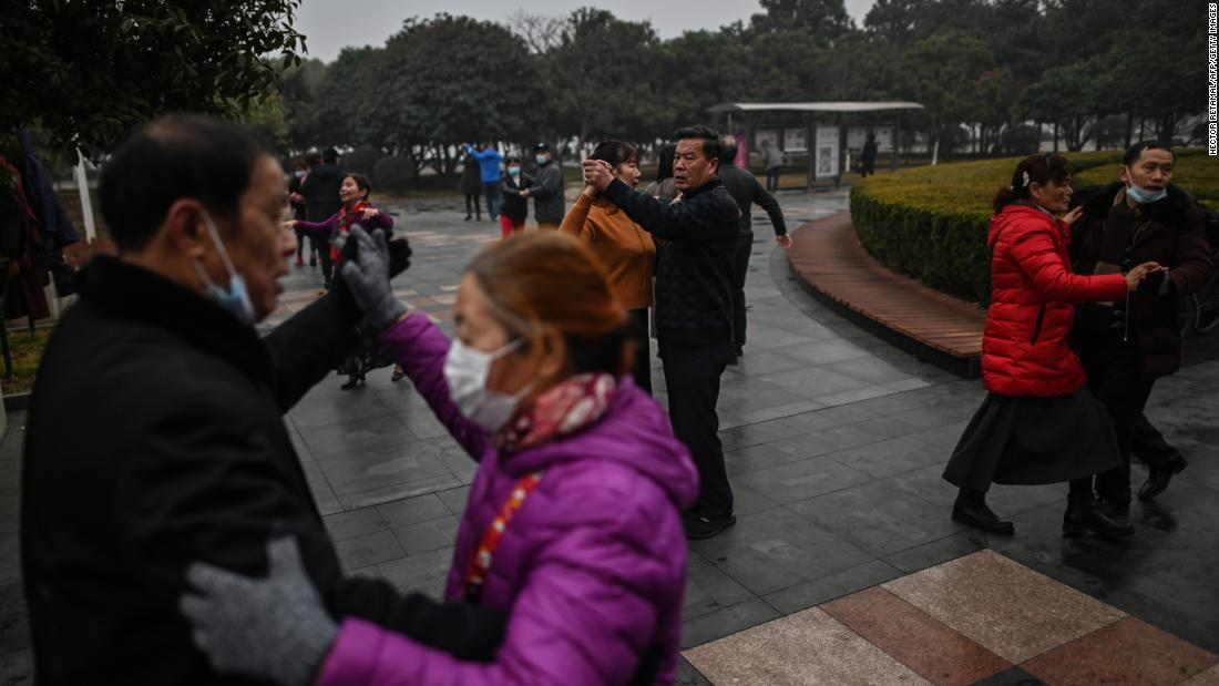 People dance in a park in Wuhan, China, on January 23, a year after the city went into lockdown to curb the spread of Covid-19.