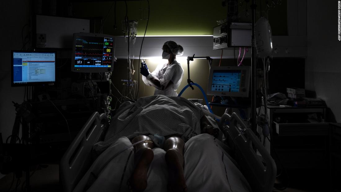 A nurse takes care of a Covid-19 patient at a hospital in Pierre-Benite, France, on January 25.