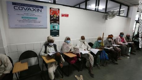 Vaccine trial volunteers wait for a dose of Covaxin at the People's Hospital in Bhopal on December 7, 2020.