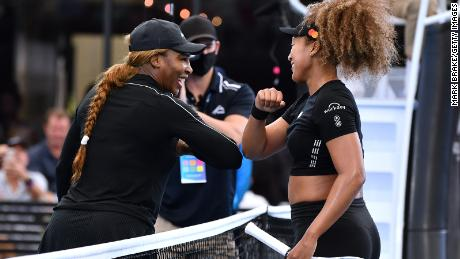 Serena Williams of the USA  elbow bumps with Naomi Osaka of Japan after their match during an exhibition tournament at Memorial Drive on January 29, 2021 in Adelaide, Australia.