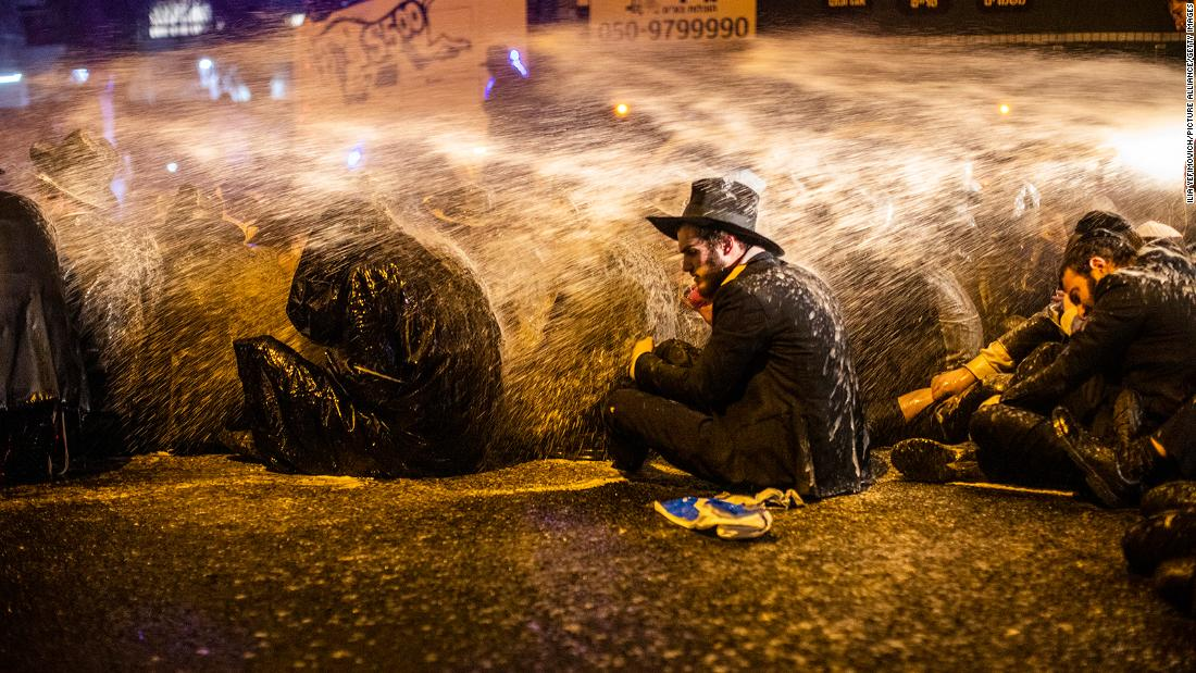 Violence and slurs from some of Israel's ultra-Orthodox Jews in battle over coronavirus lockdowns