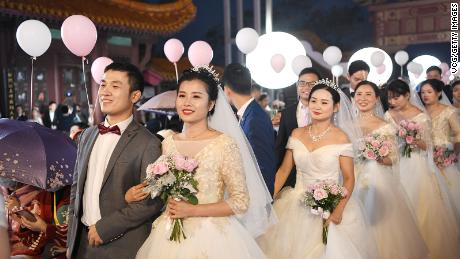 Newlywed couples from a Wuhan hospital attend a group wedding at the Yellow Crane Tower on October 20, 2020 in Wuhan, China.