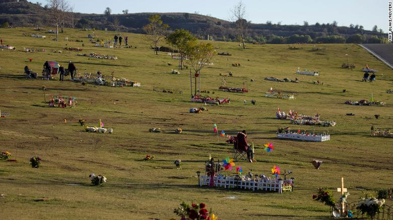 Overwhelmed by Covid deaths, America's largest cemetery refrigerates bodies — and funerals take up to a month