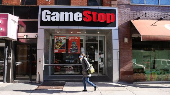 People walk by a GameStop store in Brooklyn on January 28, 2021 in New York City. Markets continue a volatile streak with the Dow Jones Industrial Average rising over 500 points in morning trading following yesterdays losses. Shares of the video game retailer GameStop plunged. (Photo by Spencer Platt/Getty Images)