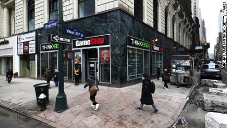 People walk past a GameStop store in Midtown Manhattan on Jan. 27.