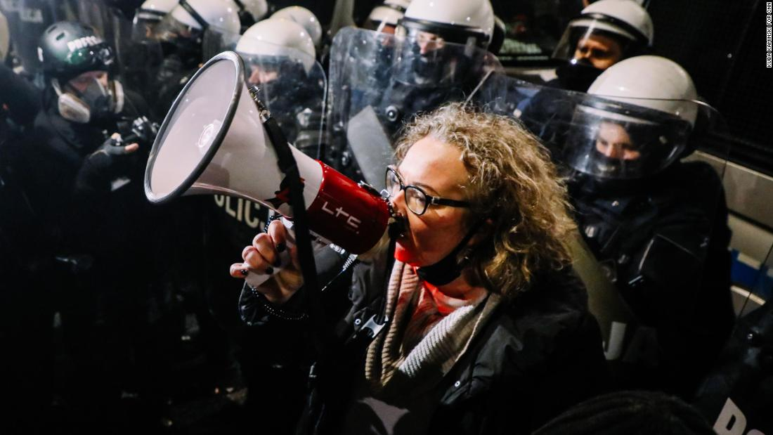 Women's Strike leader Marta Lempart rallied the protesters as they marched on Friday.