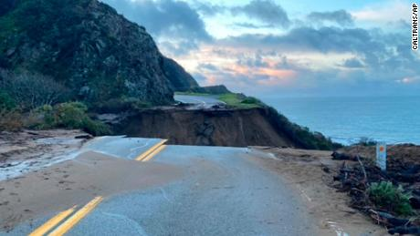 In this photo provided by Caltrans, a section of Highway 1 is shown collapsed.