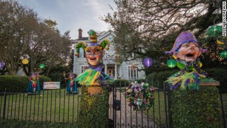 Jester decorations greet safely distanced revelers.