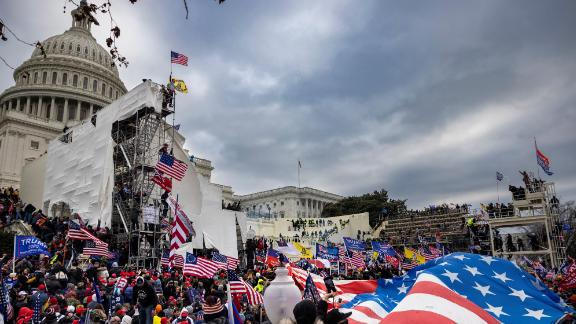 Trump supporters clash with police and security forces as people try to storm the US Capitol on January 6, 2021 in Washington, DC. Demonstrators breeched security and entered the Capitol as Congress debated the 2020 presidential election Electoral Vote Certification.