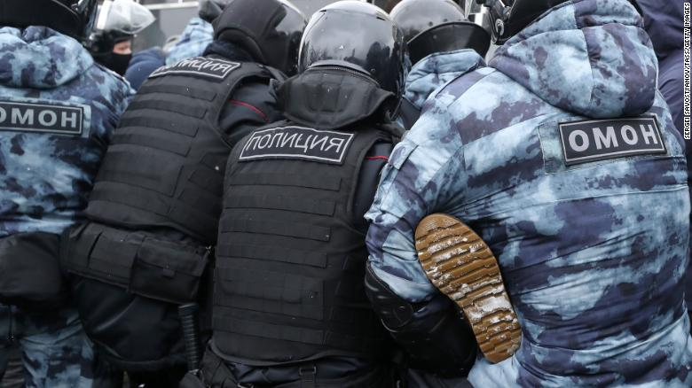 Riot police detain a participant in an unauthorized protest in support of Navalny in central Moscow on Sunday.