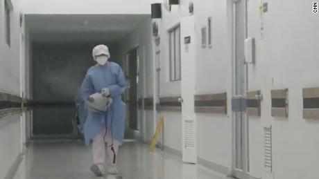 Member of the medical team disinfects the hallways at the Cardiovascular Hospital in Soacha, Colombia.