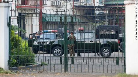 Soldiers and military vehicles are seen inside the state-run Myanmar Radio and Television Office complex, in Yangon, February 1, 2021.
