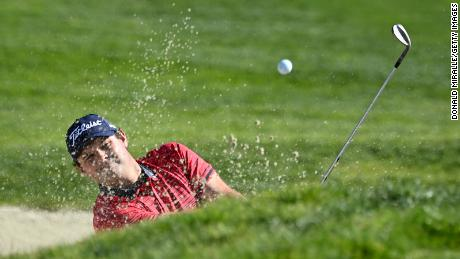 Reed hits from the bunker on the 1st hole during the final round of the Farmers Insurance Open.