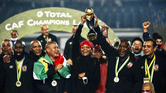 South African Pitso Mosimane celebrates with his team winning 2-1 over Zamalek in the CAF Champions League final played at the Cairo International Stadium on November 27, 2020.