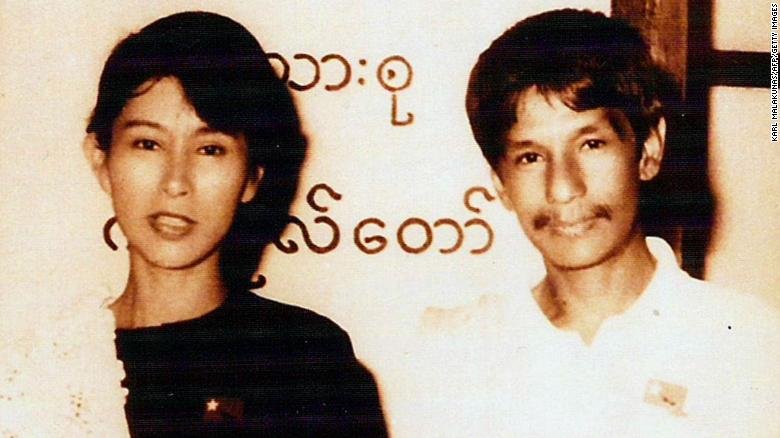 "Suu Kyi poses with Burmese comedian Par Par Lay, who was part of the pro-democracy act ""The Moustache Brothers."" Suu Kyi grew up in Myanmar and India but moved to England in the 1960s, where she studied at Oxford University. She returned to Myanmar in 1988 and co-founded the National League for Democracy, a political party dedicated to nonviolence and civil disobedience."