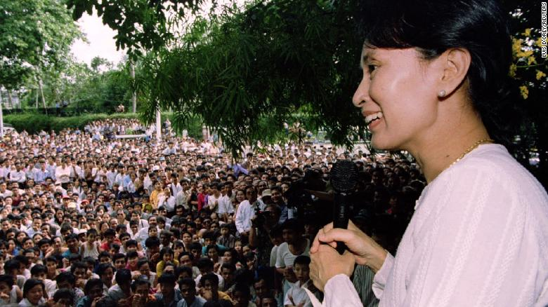 Suu Kyi speaks to hundreds of supporters from the gate at her residential compound in Yangon in 1995. She had just been released from house arrest, but her political activity was restricted.