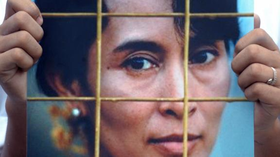 An activist holds a Suu Kyi portrait during a protest at the Chinese Embassy in Bangkok, Thailand, in 2009. The protesters were calling on the Chinese government to impose sanctions on Myanmar's military government following a Suu Kyi trial.