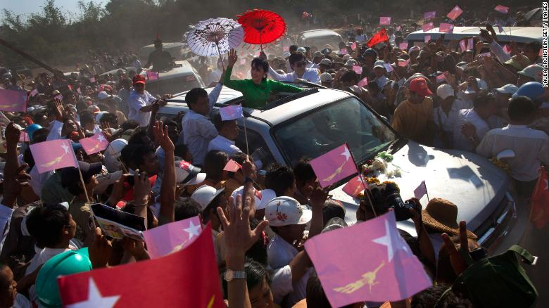 Suu Kyi greets crowds while campaigning in Pathein, Myanmar, in 2012. She was running for a seat in parliament.