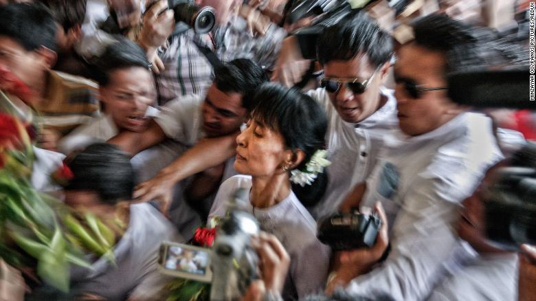 Suu Kyi makes her way through a crowd in 2012, a day after she won a seat in parliament. It was Myanmar's first multiparty elections since 1990.