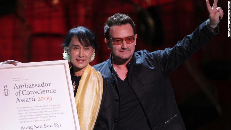 Suu Kyi accepts the Ambassador of Conscience Award next to U2 singer Bono during a European tour in 2012.