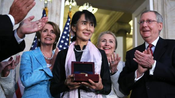 Suu Kyi is presented with the Congressional Gold Medal while visiting the US Capitol in 2012.