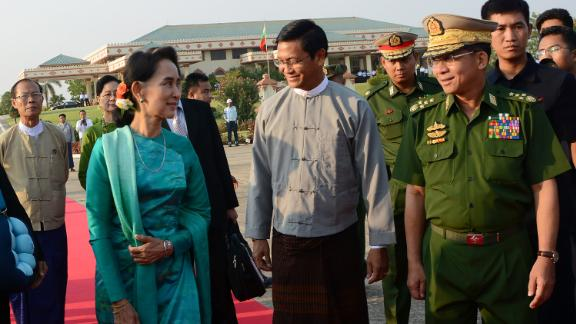 Suu Kyi walks with Gen. Min Aung Hlaing, the country's military leader, at the Naypyidaw city airport in 2016.