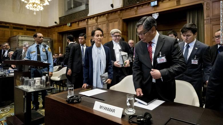 "Suu Kyi stands before the UN's International Court of Justice in 2019. The nation of Gambia filed a lawsuit in the world court <a href=""https://www.cnn.com/2019/12/13/asia/rohingya-suu-kyi-myanmar-hague-intl-hnk/index.html"" target=""_blank"">alleging that Myanmar committed ""genocidal acts""</a> against Myanmar's Rohingya Muslims. Suu Kyi has repeatedly denied such charges, siding with the military and labeling the accusations as ""misinformation."""