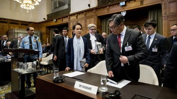 "Suu Kyi stands before the UN's International Court of Justice in 2019. The nation of Gambia filed a lawsuit in the world court alleging that Myanmar committed ""genocidal acts"" against Myanmar's Rohingya Muslims. Suu Kyi has repeatedly denied such charges, siding with the military and labeling the accusations as ""misinformation."""