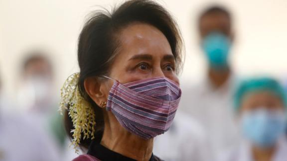 Suu Kyi watches the vaccination of health workers at a hospital in Naypyidaw in January 2021. A few days later, the military detained her in a coup.