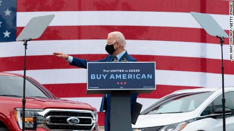 Joe Biden waves after speaking at United Auto Workers Union Headquarters in Warren, Michigan, on September 9, 2020.