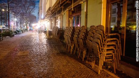 Chairs are piled on top of each other in front of a restaurant in Berlin on January 30.