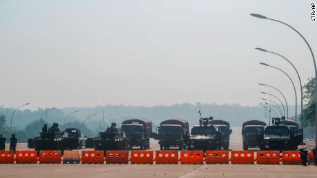 Myanmar's military stand guard at a checkpoint manned with armored vehicles blocking a road leading to the parliament building on Febuary 2, 2021, in Naypyidaw, Myanmar.