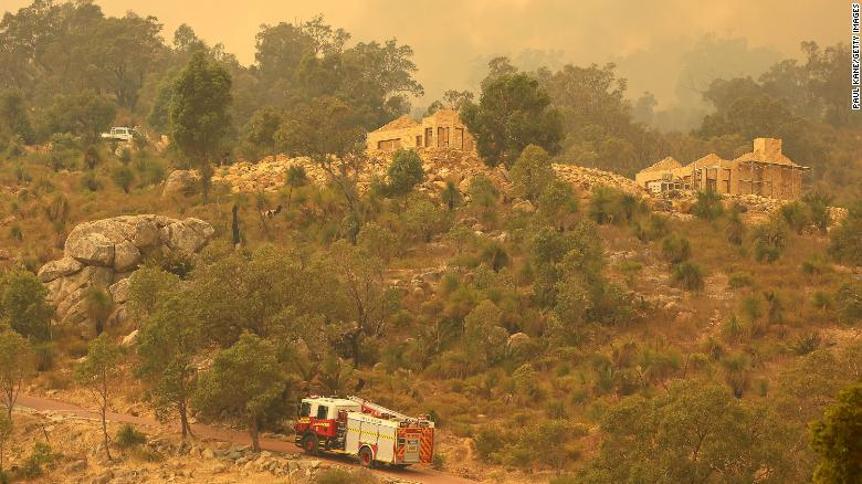 First came Covid lockdown. Now a bushfire is forcing these Australians to evacuate