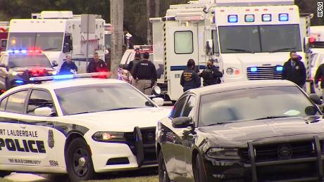 Law enforcement gather at the scene of a shooting in Sunrise, Florida, on Tuesday, February 2.