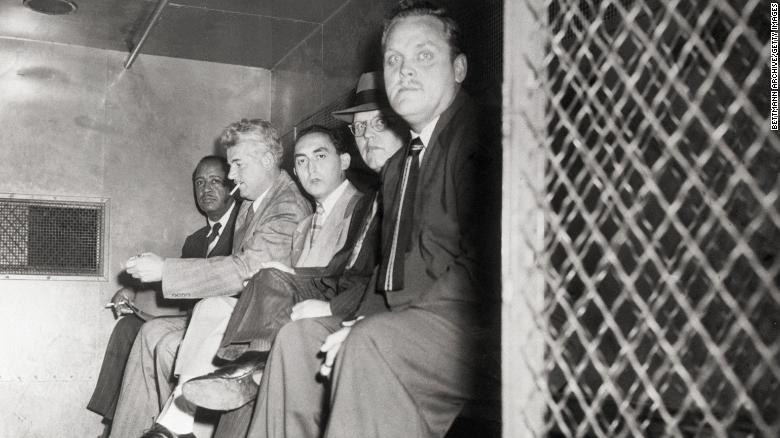 From left, Communist Party USA members Benjamin Davis Jr., Eugene Dennis, Gilbert Green, John Williamson and Gus Hall are transported to a jail cell in October 1949.